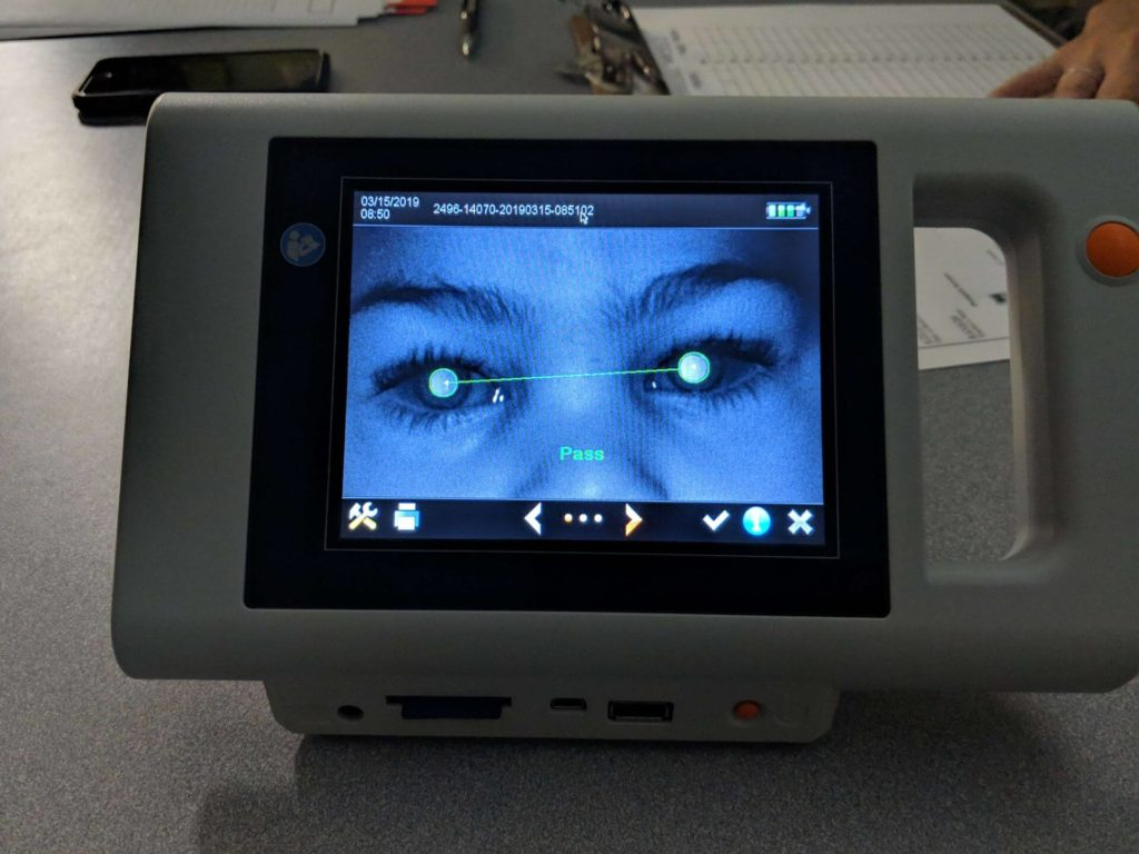Vision screening camera with passing result